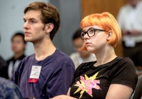 """Student Lotte Steenbrink listens to one of the ISOC briefing session speakers at IETF 87 in Berlin."""